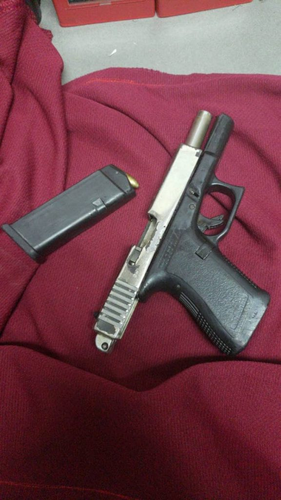 Gun found by police in Port of Spain.