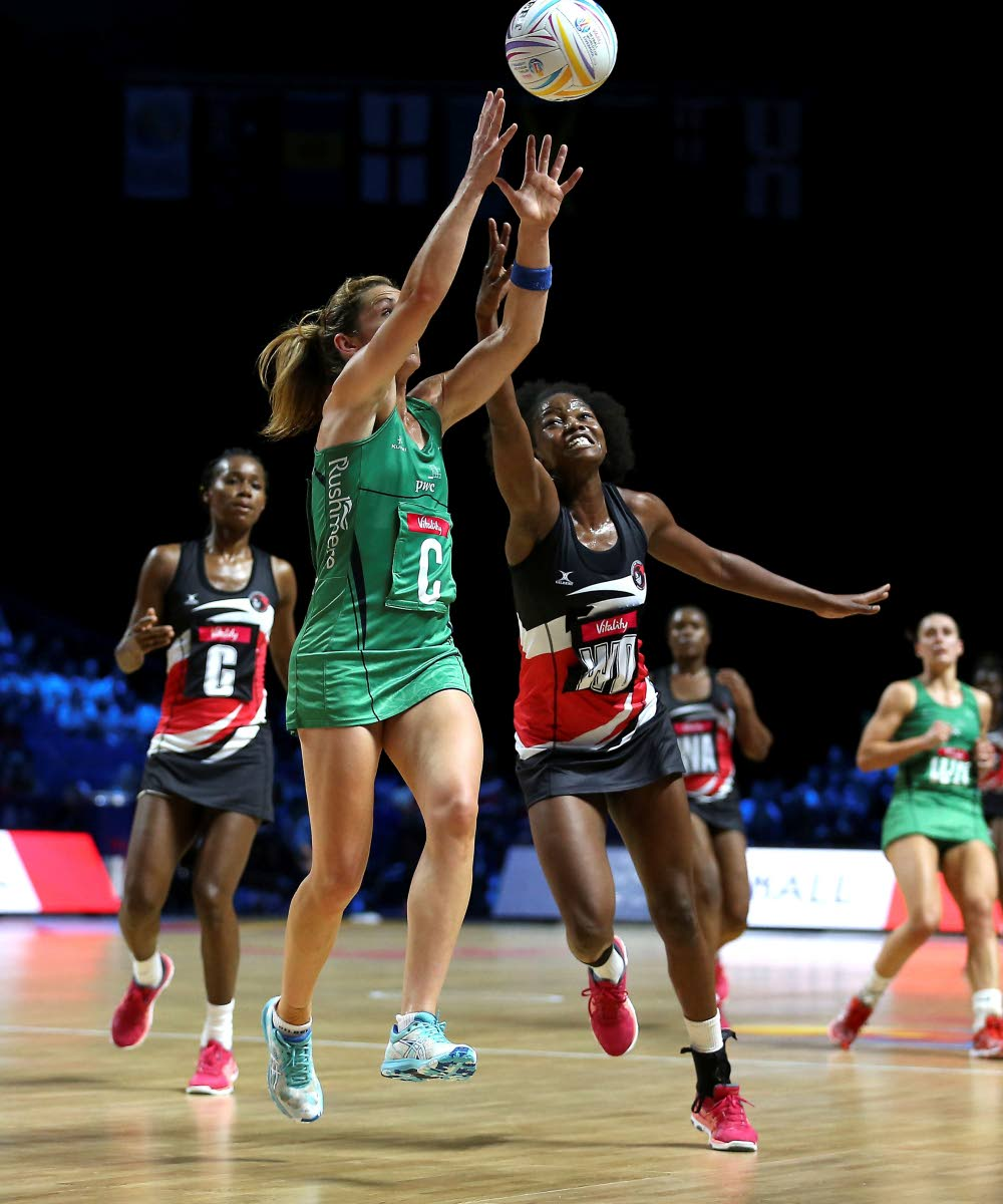Northern Ireland's Caroline O'Hanlon, centre, in action against TT during the Netball World Cup match in Liverpool, England, today. (via AP)