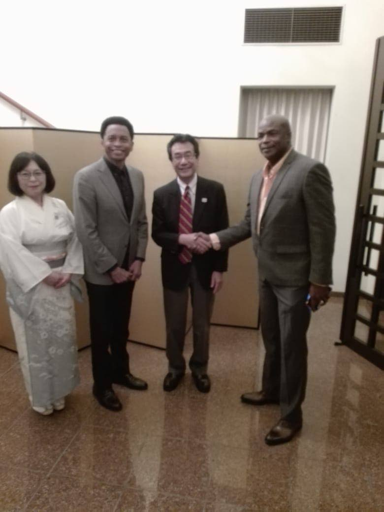 TT's first Olympic gold medallist Hasely Crawford,right, shakes hands with Ambassador to Japan Tatsuo Hirayama, at a Tokyo Olympic Games 2020 countdown celebration, at the abassador's residence, in St Clair, on Friday evening. At right, wife of the amabassador Sachiko Hirayama and TT Olympic president Brian Lewis look on.