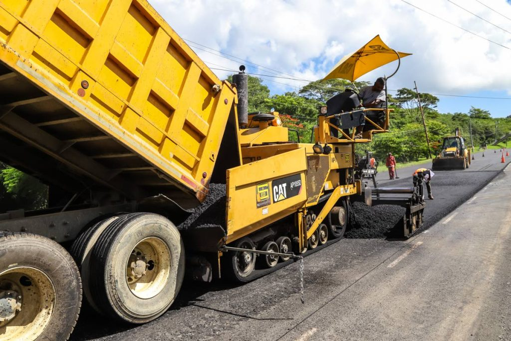 Repaving work being done on the Claude Noel highway, Tobago last week. Roger Wiggins, CEO of Lake Asphalt says TLA, a propriety blend made from TT's naturally occurring asphalt, is not mandatory for road surfacing in this country. Photo by Jeff K Mayers