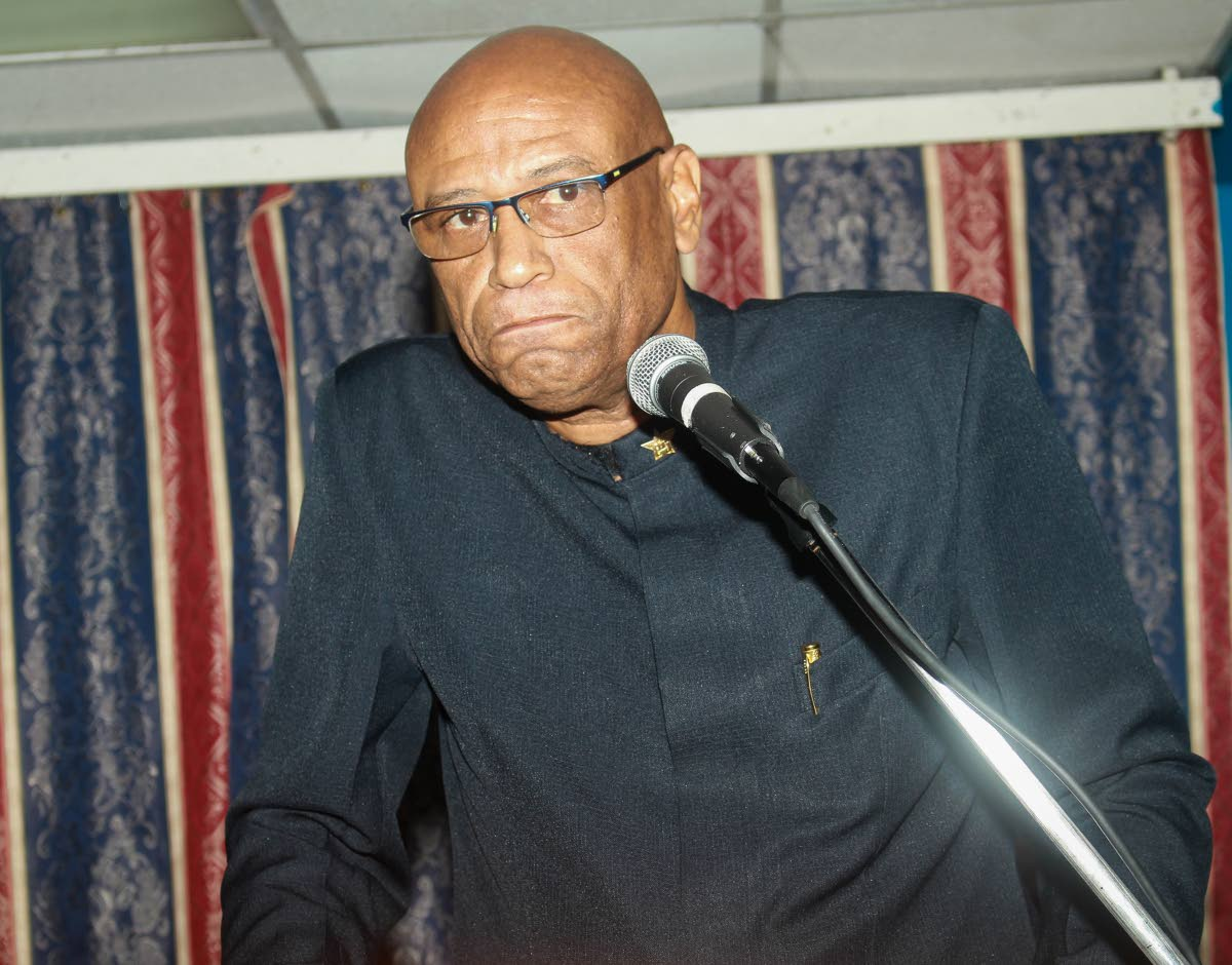 EXPOSING THEM: OWTU president general Ancel Roget speaks at the union's 80th annual Conference of Delegates last Friday at Paramount Building in San Fernando.