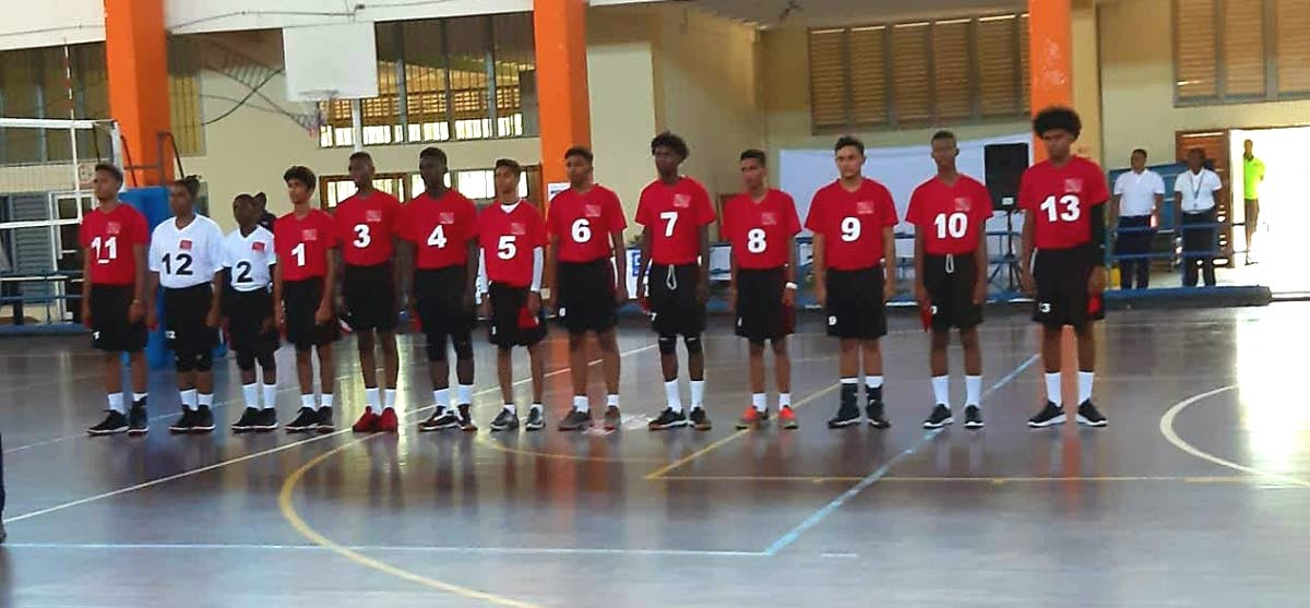 The TT Under-19 boys volleyball team prior to taking on Brabados, at the Caribbean Zonal Volleyball tournament, at St Catherine, Jamaica,yesterday.