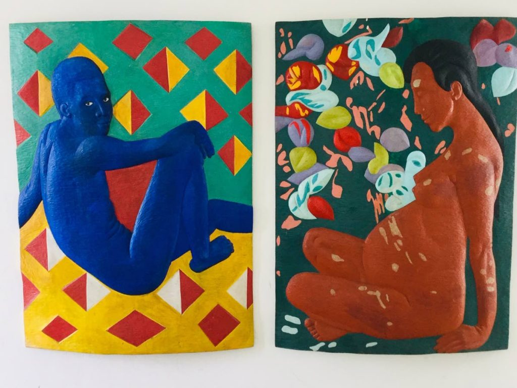 Blue boy and a mother earth figure, a pair of wall panels.