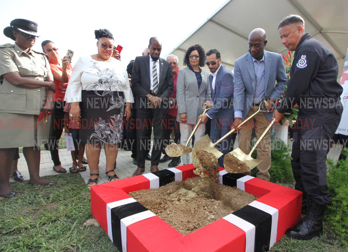 SHOVELLING DIRT: (from right) Commissioner of Police Gary Griffith, Prime Minister Dr Keith Rowley and Minister of National Security Stuart Young turn the sod to signal the start of construction of the new Carenage police station on Tuesday.  PHOTO BY ANGELO M MARCELLE
