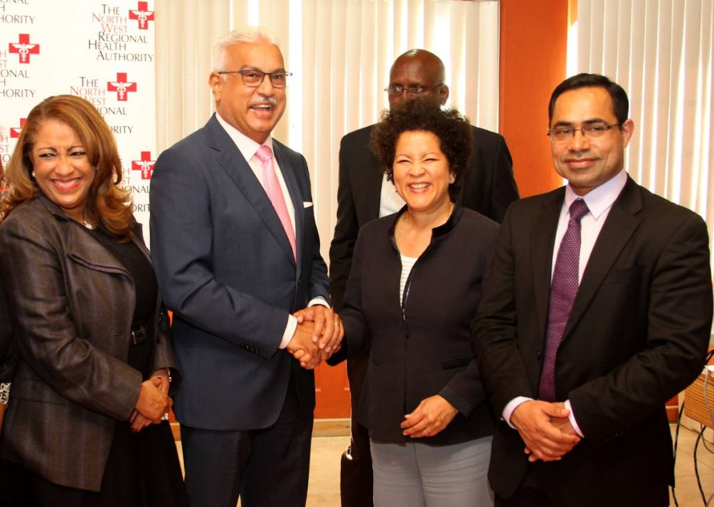 SAY CHEESE: Health Minister Terrence Deyalsingh greets Camille Chee-Awai of Transform Gobal Health, while Shubh Singh - CEO and founder of New Fields Technologies and Lisa Agard, NWRHA chairman, look on.   PHOTO BY ROGER JACOB