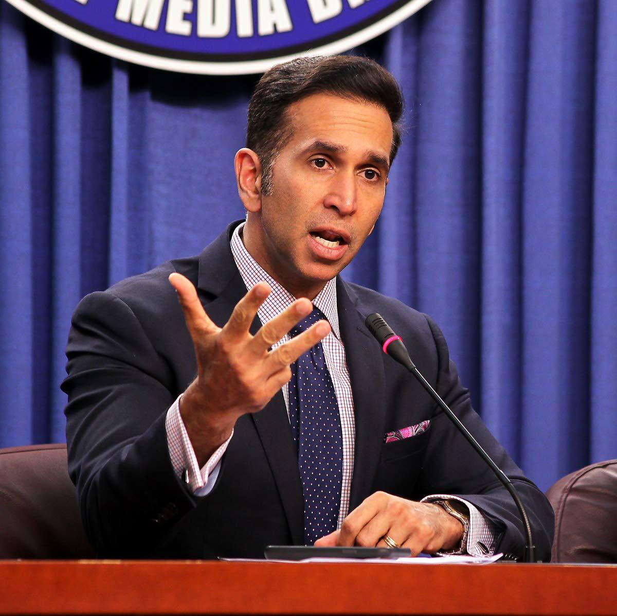 Attorney General Faris Al-Rawi speaks at yesterday's post-Cabinet media briefing.