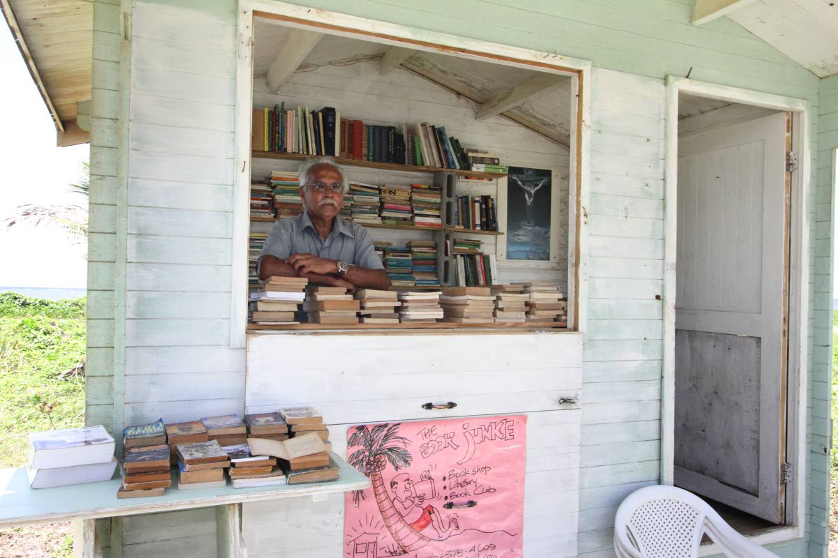 Ishmael Samad at his book shop, The Book Junkie, on Manzanilla Beach. PHOTOS BY ANGELO MARCELLE