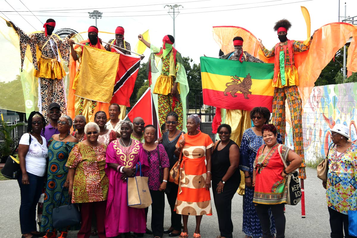 File photo: TT Association of Retired Persons' (TTARP) members pose with Kaisokah Moko Jumbies at the opening of the Lidj Yasu Omawale Emancipation Village.