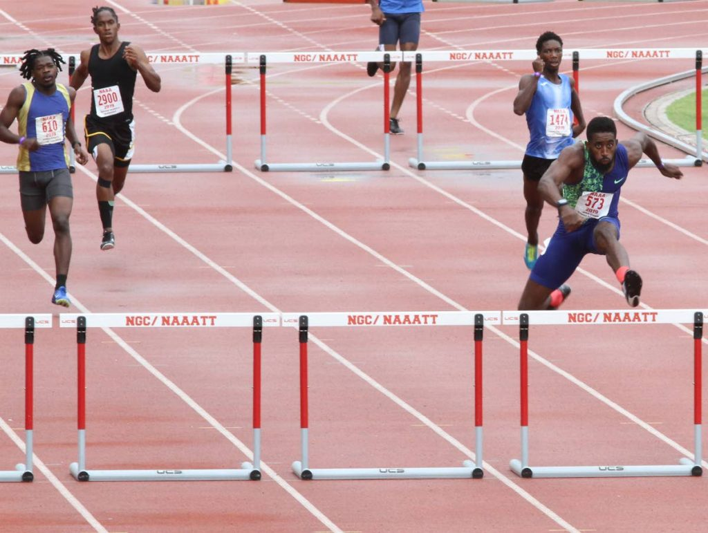 Jehue Gordon (right) on his way to gold in the men's 400m hurdles final yesterday.