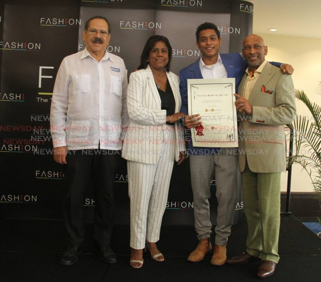 Valedictorian Andre Cournand, second from right, receives his certificate from Savile Row Academy principal Professor Andrew Ramroop, right, at FashionTT's Ultra Bespoke Tailoring Programme Certificate Distribution Ceremony at Hilton, St. Ann's, Port-of-Spain on Monday. Also in the photo are MIC-IT chairman Professor Clement Imbert and Minister of Trade and Industry Paula Gopee-Scoon. PHOTO BY AYANNA KINSALE