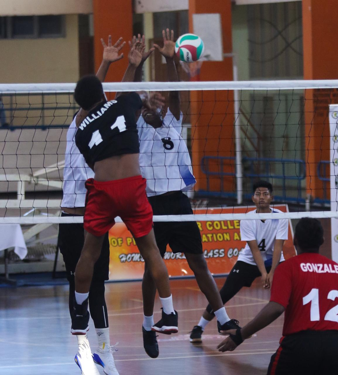 Captain Nicholas Williams spikes a ball against Suriname yesterday at the CAZOVA U19 Boys Championship, St. Catherine, Jamaica. Photo by Sherdon Pierre