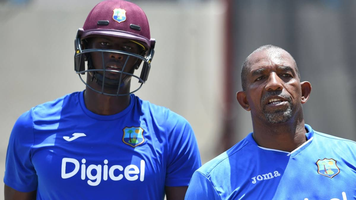 Former West Indies coach Phil Simmons (right) alongside Test and ODI captain Jason Holder.