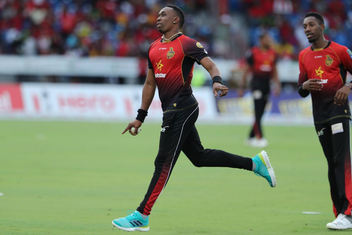 In this August 19, 2018 file photo Dwayne Bravo of Trinbago Knight Riders celebrates a wicket during the Hero Caribbean Premier League match between Jamaica Tallawahs and Trinbago Knight Riders at Central Broward Regional Park, in Fort Lauderdale, Florida. Also in photo is TKR's Khary Pierre (right).