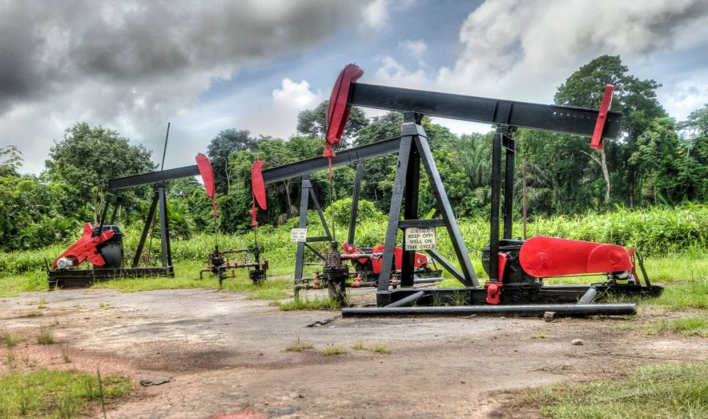 Pumping jacks once along Petrotrin Field Road in south Trinidad.  The state oil company was closed down in 2018 because of multi-billion dollar losses over the years. TT's economy has been pegged on oil and gas for 57 years.  Photo by Jeff K. Mayers