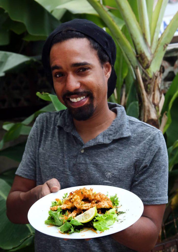 Trevor Hosten Jr serves up coconut shrimp.