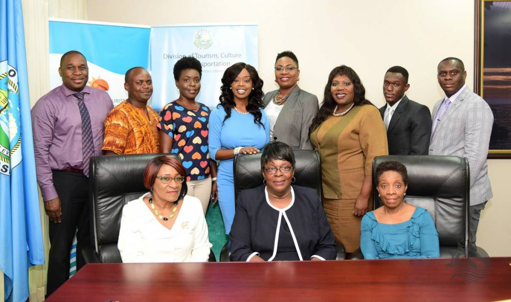READY TO SERVE: New Tobago Festivals Commission chairman Dr Suzanne Burke, seated front right, with other members of the board and Culture Secretary Nadine Stewart-Phillips, fourth from left, back row, after receiving their instruments of appointment on Monday.