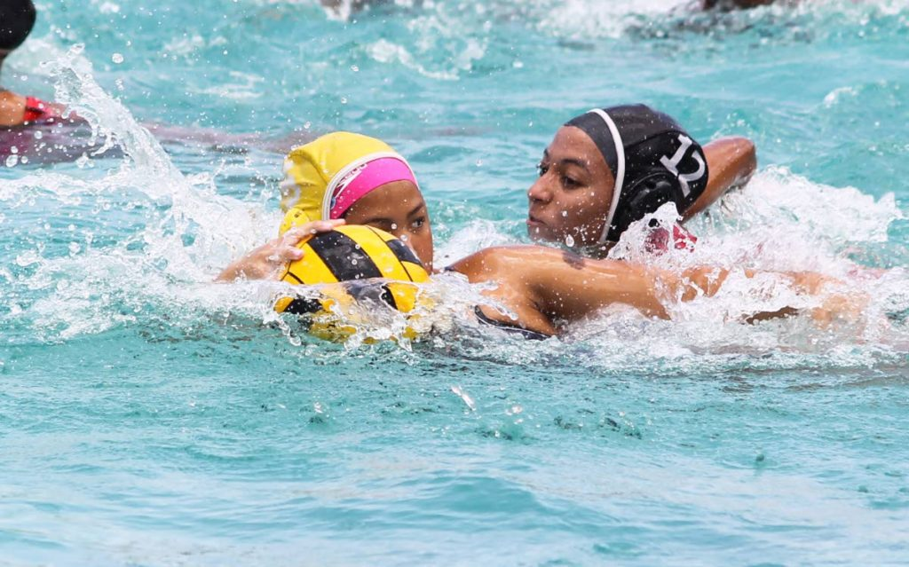Victoria Gillette tries to keep possession of the ball in a TT girls Under-17 water polo training session at Marlins Swim Club in Westmoorings, recently. PHOTO BY ROGER JACOB.
