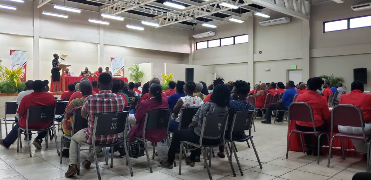 PNM members listen as emcee Melissa James-Guy speaks during a constituency meeting at Lowlands Multipurpose Facility on Tuesday.