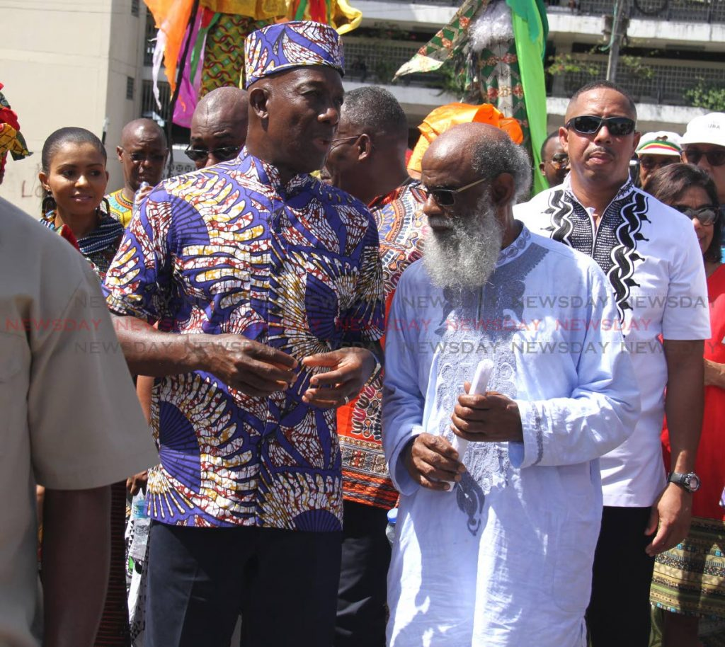 Prime Minister Dr Keith Rowley with chairman of the Emancipation Support Committee of TT Khafra Kambon during the Emancipation Day procession in Port-of-Spain last Thursday. PHOTO BY AYANNA KINSALE