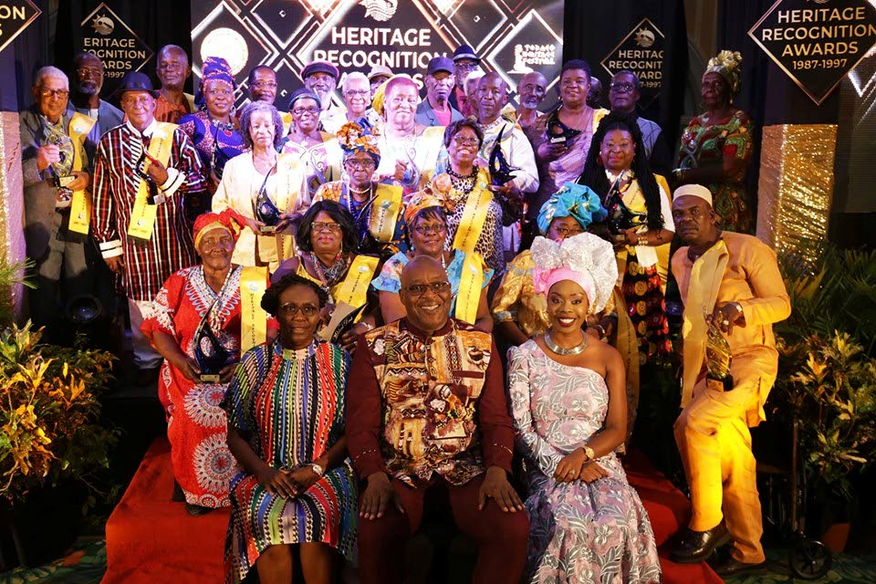 CULTURE ICONS: (Seated from left in the front row) Tourism, Culture and Transportation Division administrator Selma Graham, Chief Secretary Kelvin Charles and the Division's Secretary Nadine Stewart-Phillips, alongside the Tobago Heritage Festival's pioneers at last Tuesday's Inaugural Heritage Recognition Awards at the Magdalena Grand Beach and Golf Resort, Lowlands. PHOTO COURTESY THA