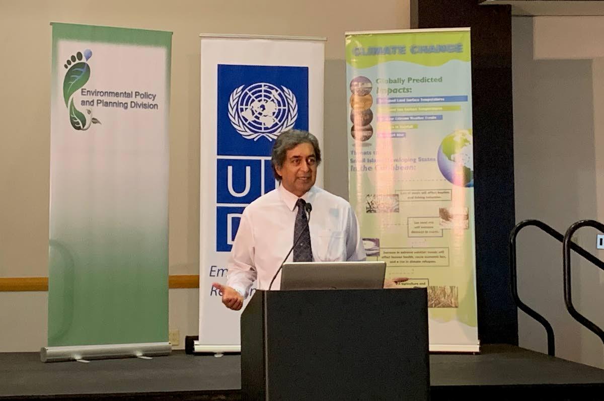 Kishan Kumarsingh speaking at the sensitisation session on climate change confrence at the Hyatt.