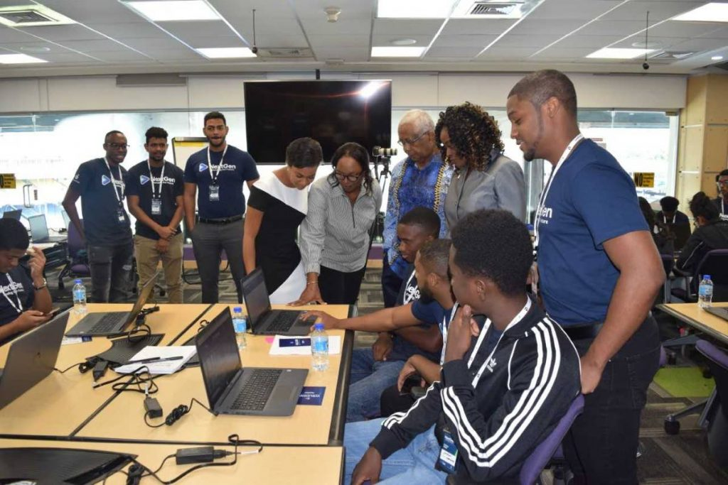 Participants learn about ICT at the launch of the NextGen Tech Education Coding Camps hosted by BPTT at the Queen's Park Oval, Port of Spain on August 3. Education Minister Anthony Garcia spoke at the event which is endorsed by the Education Ministry. PHOTO COURTESY MINISTRY OF EDUCATION