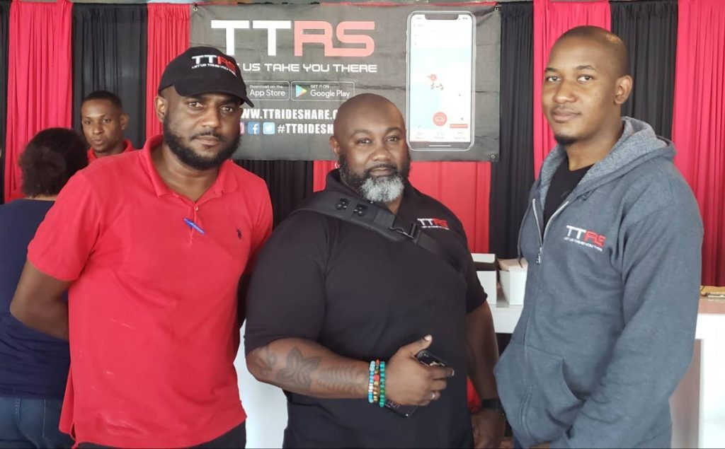 TTRideShare directors (from left) Gerrard Small, Jadon LaCroix and Dwight Housand at Gulf City Mall, Lowlands.