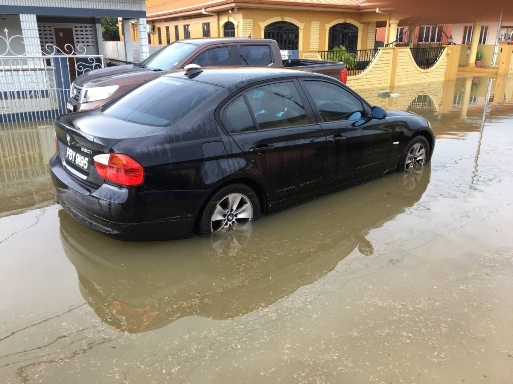 A car stalled in flood waters in Beaulieu Avenue, Trincity.