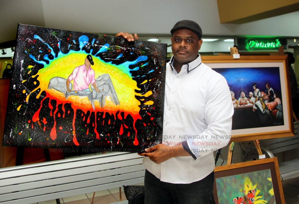 Inmate Andrew Douglas displays his painting Cultural Explosion.