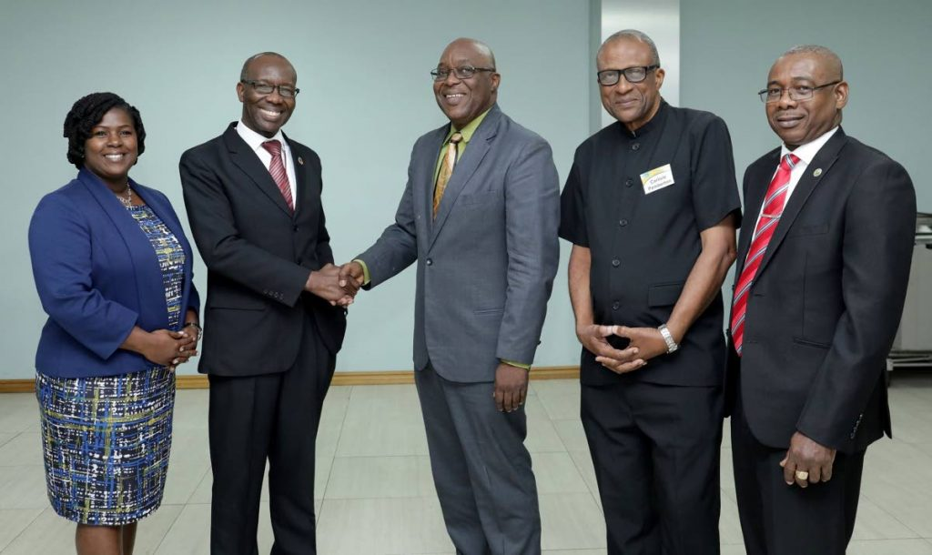AGRICULTURAL TALK: (From left) Senator Allison DeGazon- Chair, Economic Developement Regulations and Agriculturre Committee-US Virgin Islands; Willard Phillips- Economics Affairs Officer, ECLAC; Chief Secretary Kelvin Charles; Professor Carlisle Pemberton, president, Caribbean Agro-Economics Society; Food Secretary Hayden Spencer at the 33rd West Indies Agriculture Economics Conference on Monday. PHOTO COURTESY THA