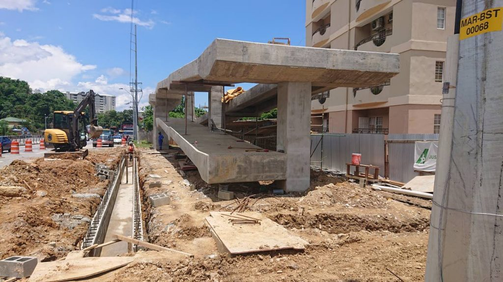 Construction of the Diego Martin overpass continues near the Four Roads intersection of the Diego Martin Highway yesterday.