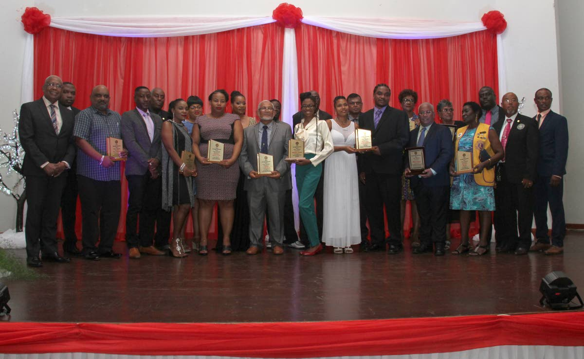 Minister of Education Anthony Garcia, left, with awardees at the Arima Borough Council Annual Award Ceremony at the Arima New Government School Auditorium last Wednesday.