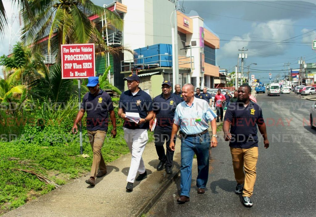 JTUM members on a walkabout in Point Fortin on Friday. PHOTO BY CHEQUANA WHEELER