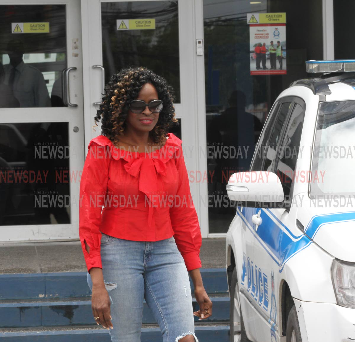 Newly appointed Minister of Communications Donna Cox, leaves the St Joseph Police Station after visiting Port of Spain South MP Marlene Mc Donald, on Sunday. PHOTO BY ANGELO MARCELLE