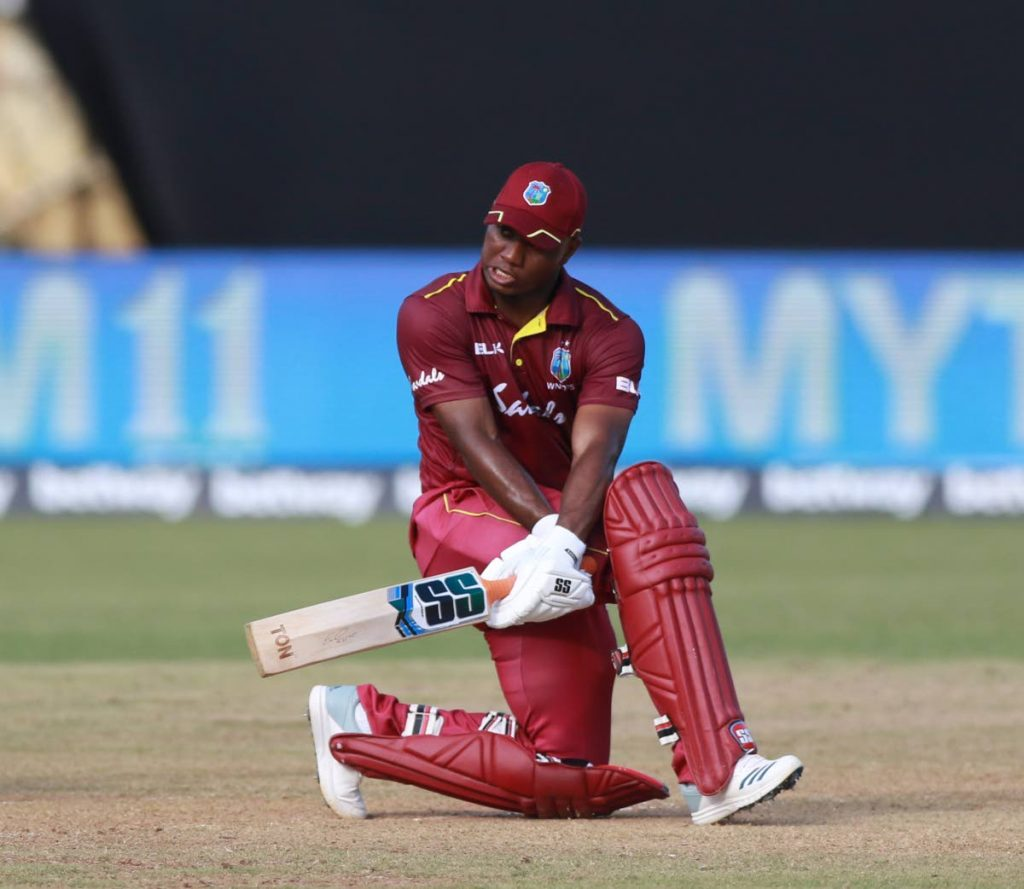 West Indies batsman Evin Lewis hits a sweep shot during the one-day match against India at the Queen's Park Oval, Port of Spain, yesterday. NICHOLAS BHAJAN/CA-images
