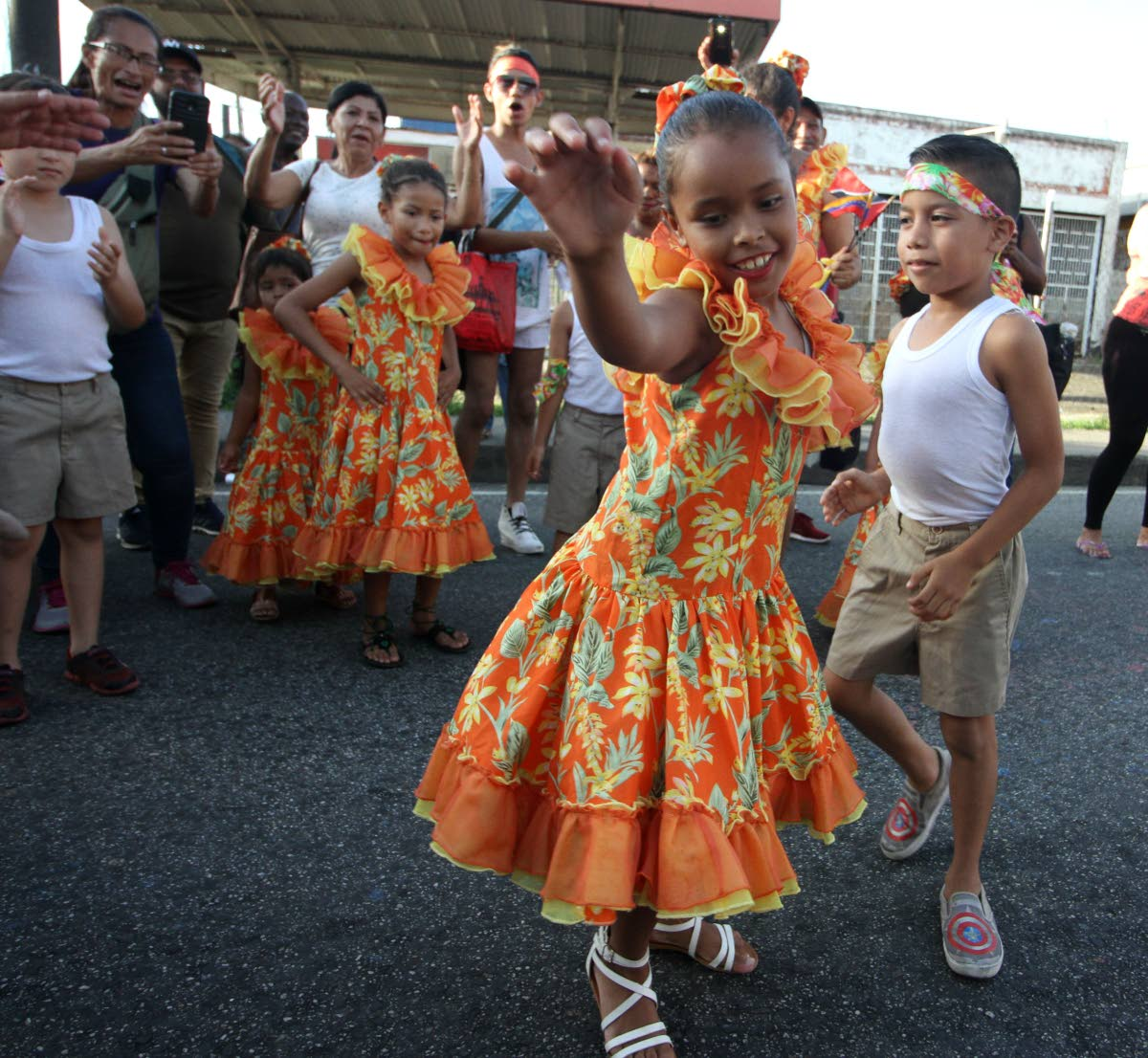 Two members of La Burriquitas dance during Arima Borough Day celebrations on Saturday.
