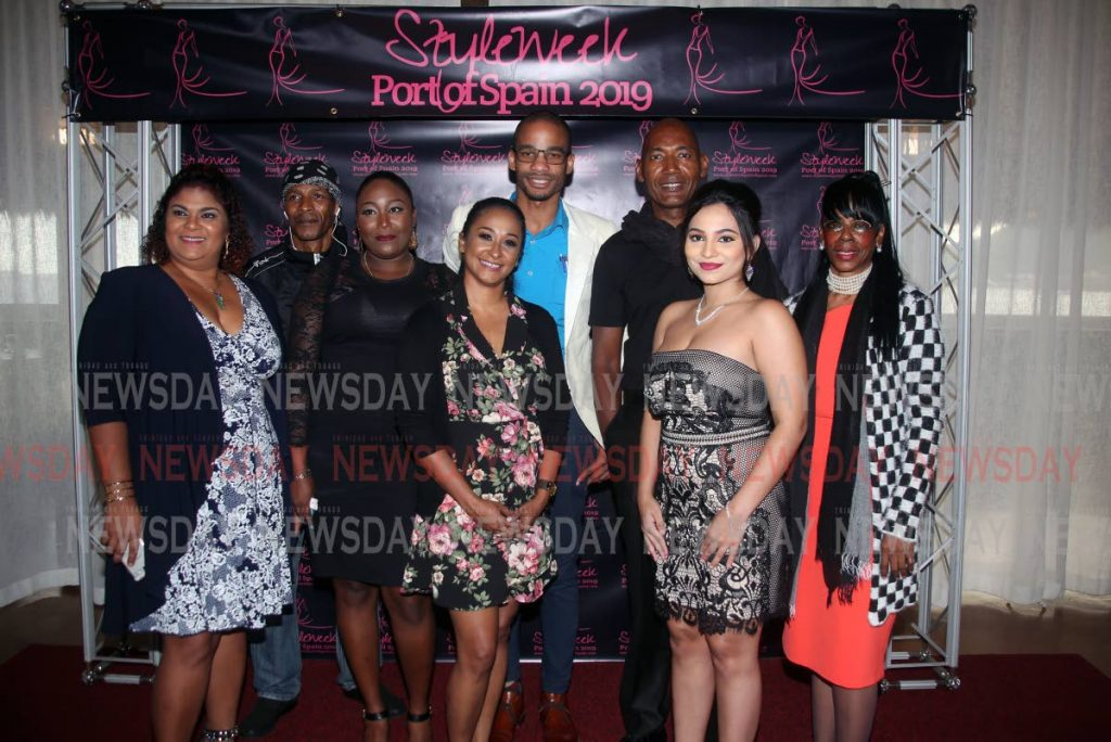 PASSING THE TORCH: At the launch of Style Week Port of Spain 2019, fashion consultant Christopher Nathan, third from right, stands with representatives of new franchise holders Zetick Caribbean Fazia Khan, Errol Boneo, Samantha Williams, Shunnel Roopchand, Augustus Joel, Annalisa Ramsarran and Angela Pierre at Boqueron Seafood and Tapas Resturant in Chaguaramas last Friday. PHOTO SUREASH CHOLAI