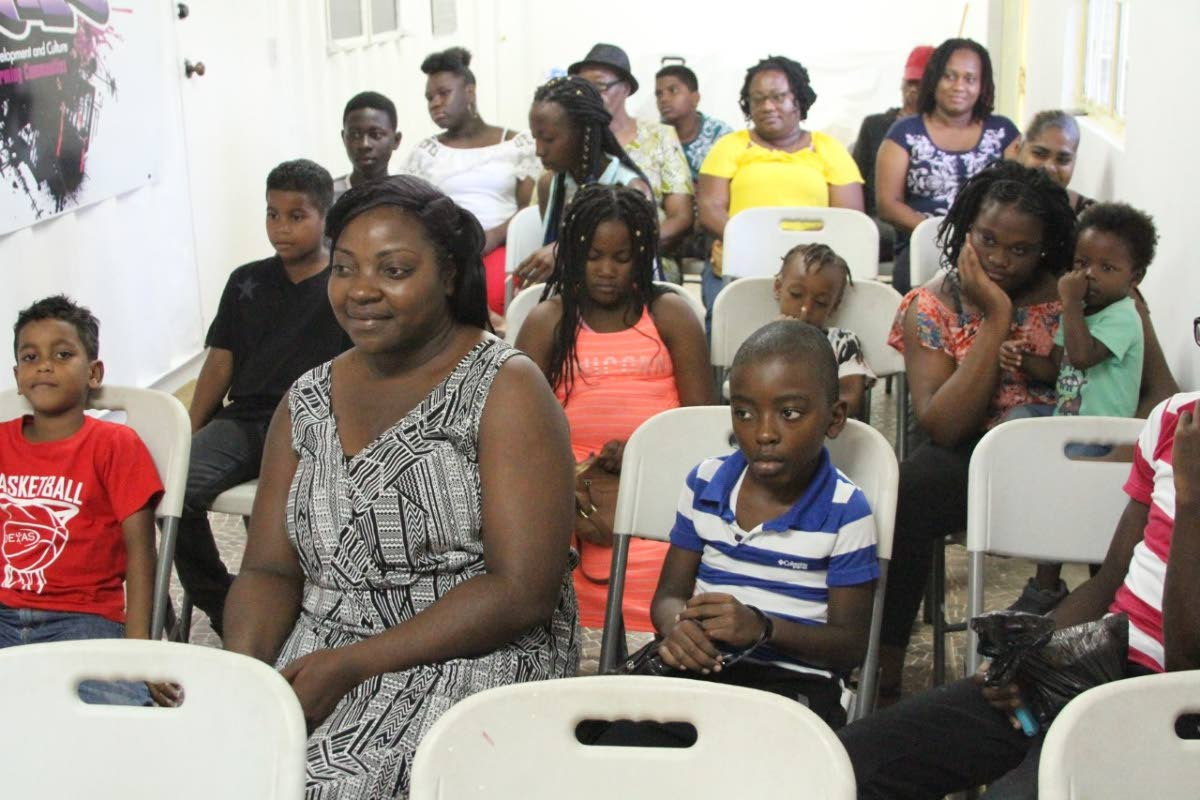 Attendees at the launch of the Mason Hall Police Youth Club literacy programme on August 2.