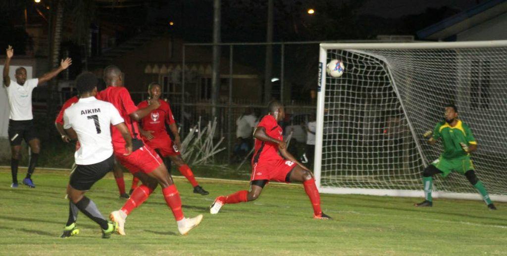 In this August 12 file photo, Terminix La Horquetta's Aikim Andrews (second from left) fires a shot at goal during the Ascension Invitational Football Tournament encounter against Matura ReUnited at the La Horquetta Recreation Ground.