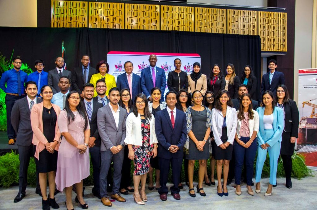Energy Minister Franklyn Khan, back row, left of centre, Prime Minister Dr Keith Rowley and Parliamentary Secretary in the Ministry of Energy Nichole Olivierre with participants of the Three-Tier Mentorship Programme for Energy Professionals at it's launch at the Hyatt Regency, Port of Spain, yesterday.