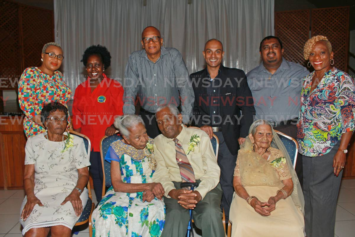 Honourary centenarians, front row, with San Fernando Mayor Junia Regrello, back row, third from left, and city coucillors at the Centenarian Honourary function held at City Auditorium, San Fernando, on Thursday night. PHOTO BY CHEQUANA WHEELER
