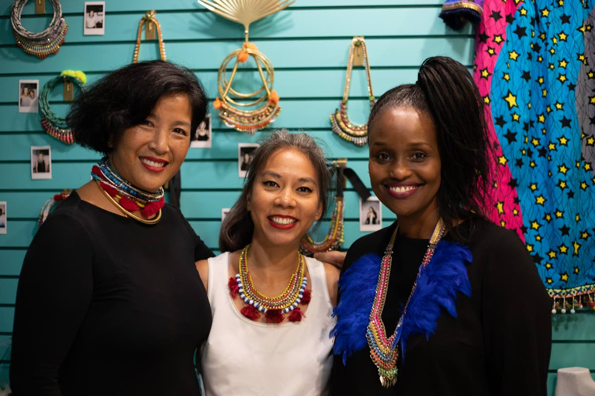 Nicole Akong centre, with friends, owner of Diamond Boulevard Gigi Morley and owner of B3 Wine and Spirits Donna Chin Lee.  Photo: Brendan Delzin