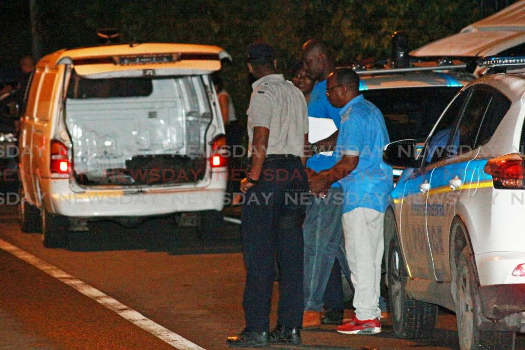 Police and other officials outside the house in which a toddler and a baby were found with the decomposing bodies of their parents and uncle at Clarke Road, Penal, on Thursday. PHOTO BY CHEQUANA WHEELER
