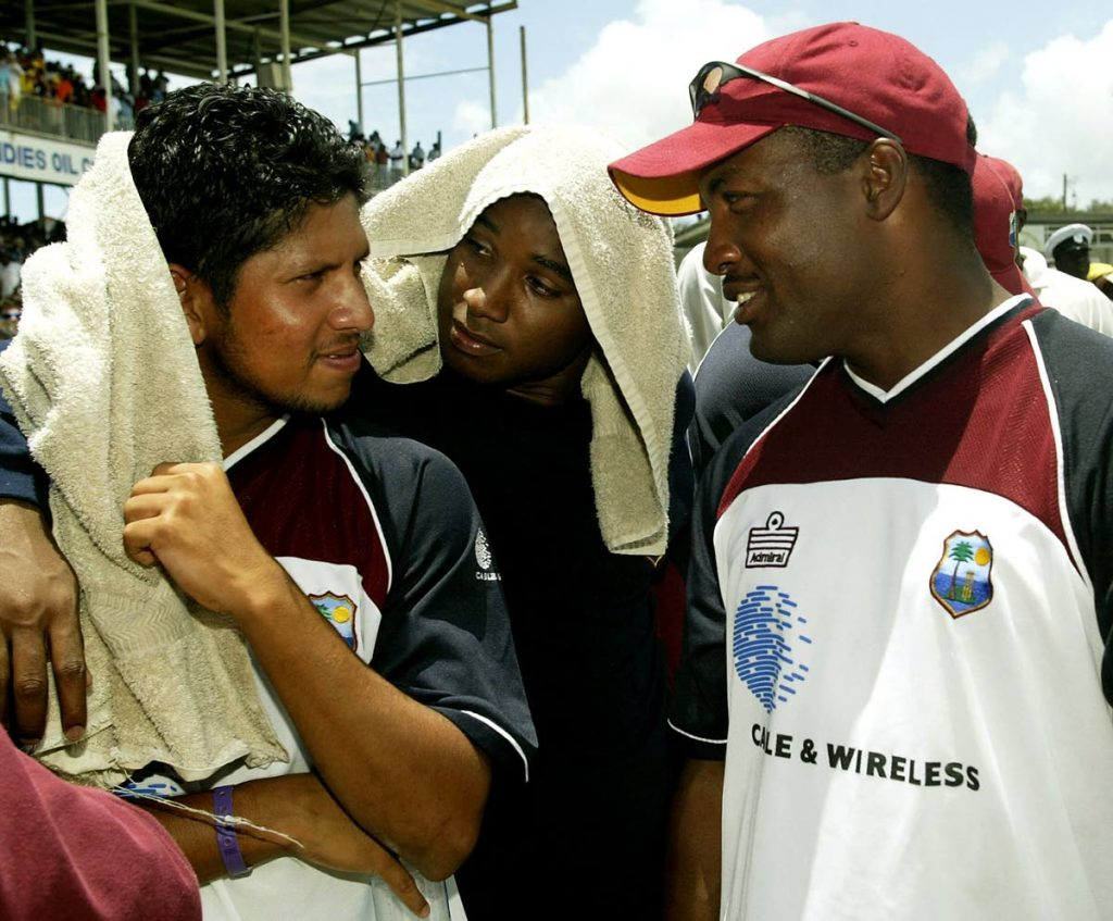 File photo: Brian Lara (right) speaking to Ramnaresh Sarwan (left) and Tino Best after the West Indies' historic victory over Australia in the fourth and final Test match of the 2003 series at the Antigua Recreation Ground, St John's, Antigua.