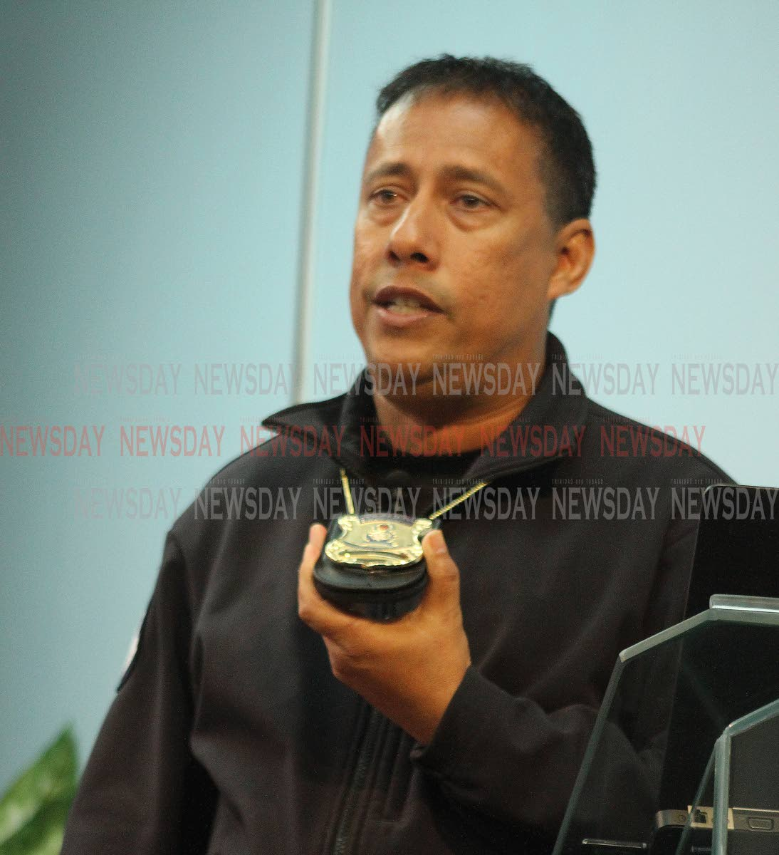 Commissioner of Police Gary Griffith shows the new police identification badge as he addresses the media at the Police Administration Building, Port of Spain, yesterday. PHOTO BY ANGELO MARCELLE
