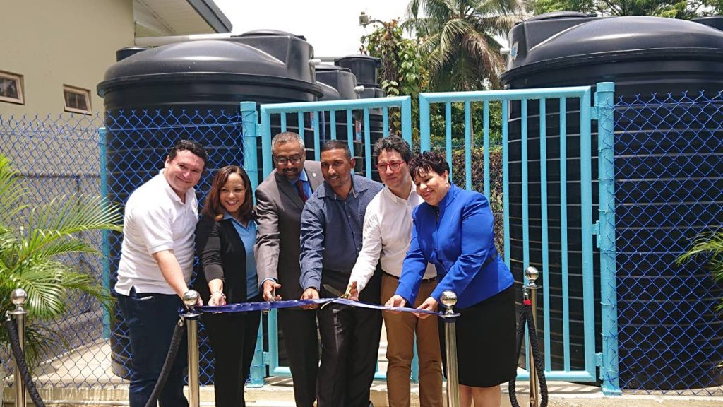 MP for Cumuto/Manzanilla Christine Newallo-Hosein, right, and other officials cut  the ribbon at the end of the project.