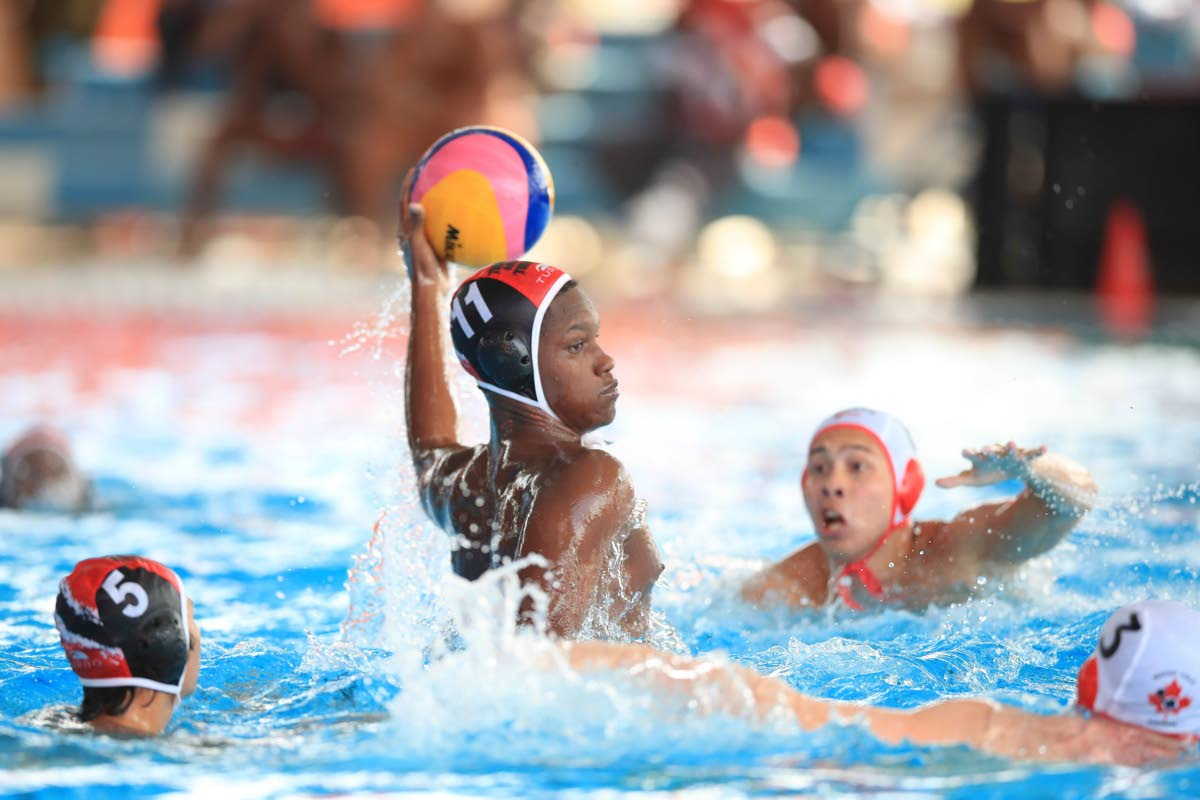 TT's Kelvin Caesar (#11) prepares to shoot at goal, during the UANA Waterpolo Youth Championship between TT and Canada at the National Aquatic Centre, Couva, yesterday Canada won 23-5.