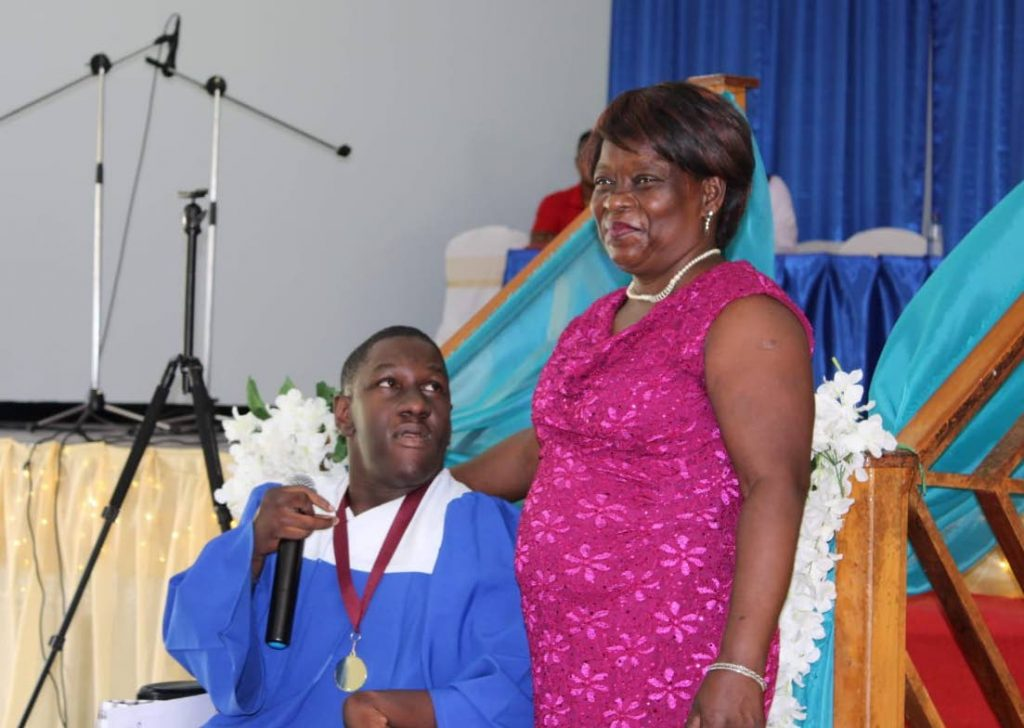 Josiah Thomas of New Grant Secondary School during his graduation with his mother Sharon Thomas