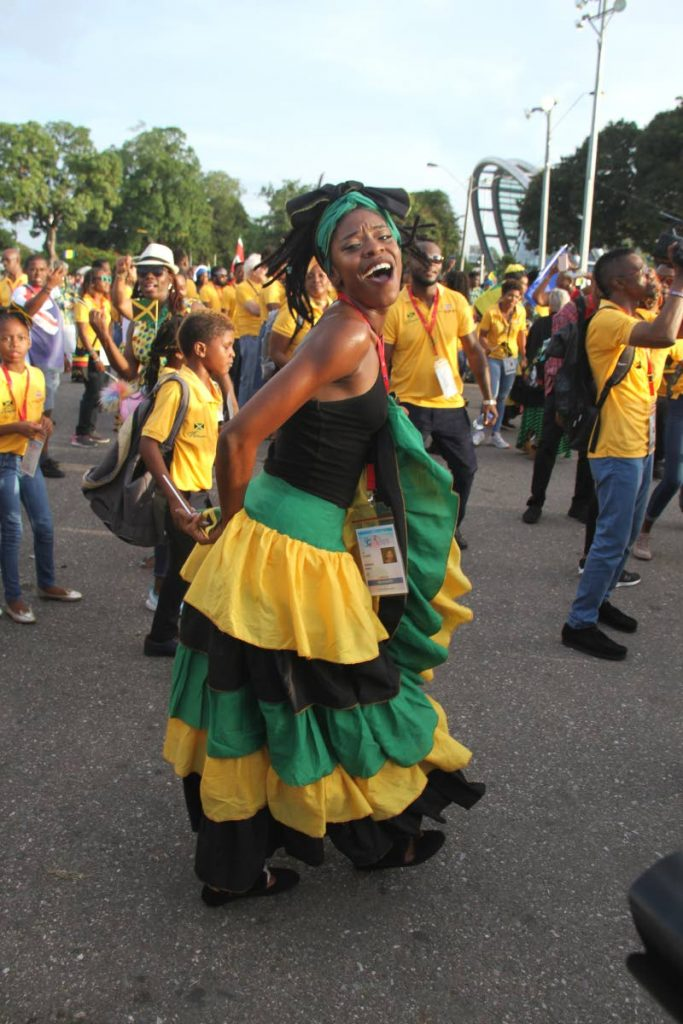 A member of the Jamaica delegation dances during the Carifesta parade in Port of Spain on Friday.