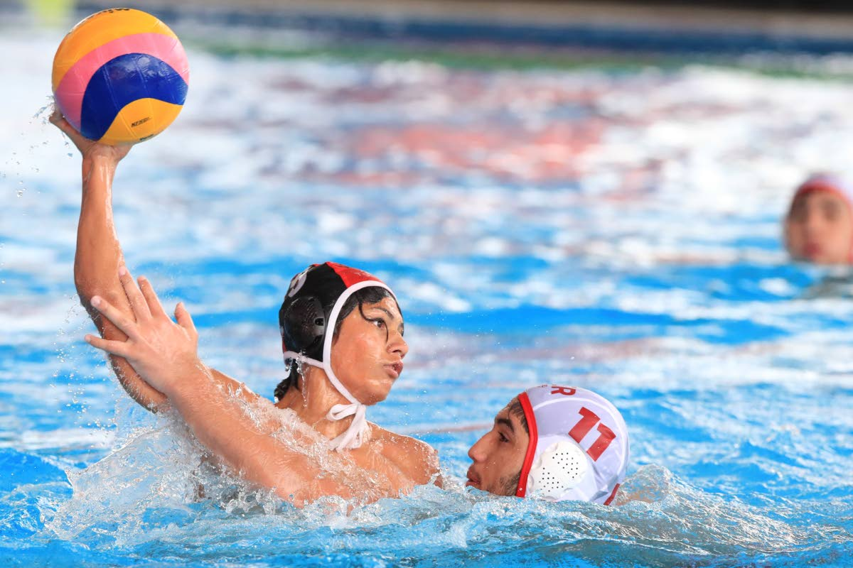 TT's Ross Gillette takes a shot at goal as Peru's Felipe Ignacio commits a foul, in the UANA Waterpolo Youth Championship yestedray at the National Aquatic Centre, Couva. PHOTO BY ALLAN V CRANE/CA-IMAGES